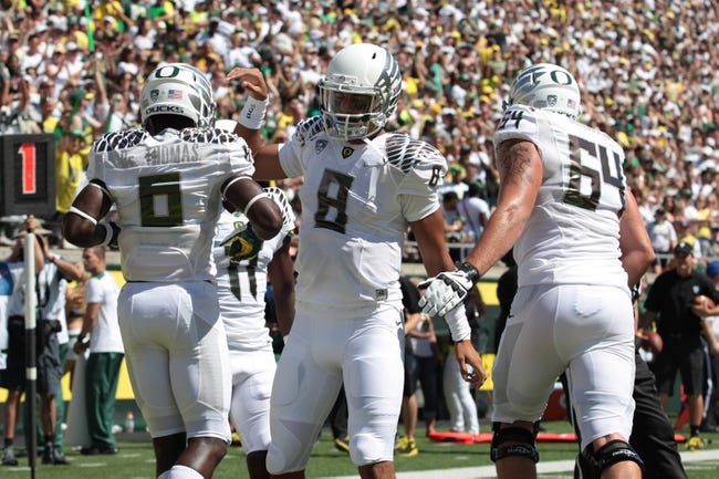 Aug 31, 2013; Eugene, OR, USA; Oregon Ducks quarterback Marcus Mariota (8) celebrates with running back De'Anthony Thomas (6) following a touchdown against the Nicholls State Colonels at Autzen Stadium. Mandatory Credit: Scott Olmos-USA TODAY Sports