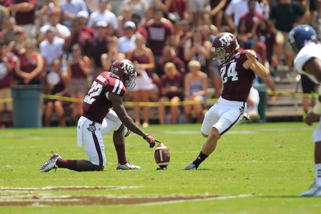 Aug 31, 2013; College Station, TX, USA; Texas A&M Aggies kicker Taylor Bertolet (24) kicks off against the Rice Owls during the second quarter at Kyle Field. Mandatory Credit: Thomas Campbell-USA TODAY Sports