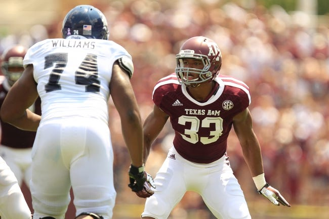 Aug 31, 2013; College Station, TX, USA; Texas A&M Aggies linebacker Shaan Washington (33) defends against the Rice Owls during the second quarter at Kyle Field. Mandatory Credit: Thomas Campbell-USA TODAY Sports