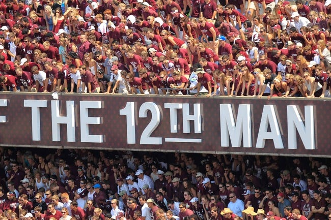 Aug 31, 2013; College Station, TX, USA; Texas A&M Aggies students yell against the Rice Owls during the first quarter at Kyle Field. Mandatory Credit: Thomas Campbell-USA TODAY Sports
