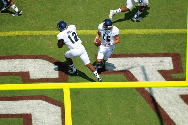 Aug 31, 2013; College Station, TX, USA; Rice Owls quarterback Taylor McHargue (16) fakes a hand off to running back Charles Ross (12) against the Texas A&M Aggies during the first quarter at Kyle Field. Mandatory Credit: Thomas Campbell-USA TODAY Sports