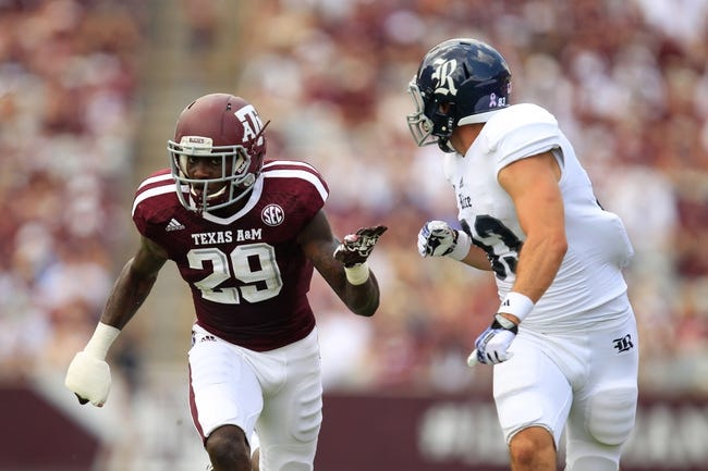 Aug 31, 2013; College Station, TX, USA; Texas A&M Aggies defensive back Deshazor Everett (29) defends Rice Owls wide receiver Andre Gautreaux (83) during the second half at Kyle Field. Texas A&M won 52-31. Mandatory Credit: Thomas Campbell-USA TODAY Sports