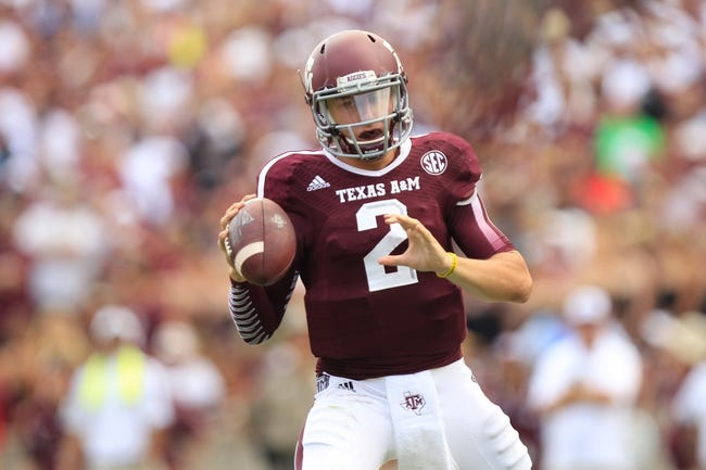 Aug 31, 2013; College Station, TX, USA; Texas A&M Aggies quarterback Johnny Manziel (2) drops back against the Rice Owls during the third quarter at Kyle Field. Mandatory Credit: Thomas Campbell-USA TODAY Sports