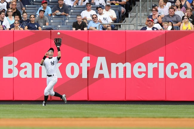 Aug 31, 2013; Bronx, NY, USA; New York Yankees right fielder Ichiro Suzuki (31) makes a catch against the Baltimore Orioles during a game at Yankee Stadium. Mandatory Credit: Brad Penner-USA TODAY Sports