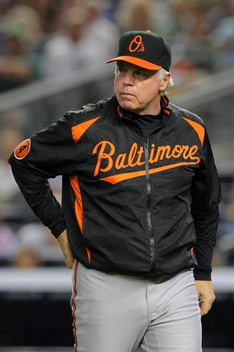 Aug 30, 2013; Bronx, NY, USA; Baltimore Orioles manager Buck Showalter (26) on the field during a game against the New York Yankees at Yankee Stadium. Mandatory Credit: Brad Penner-USA TODAY Sports