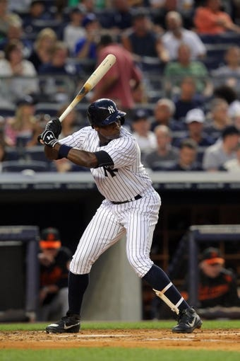 Aug 30, 2013; Bronx, NY, USA; New York Yankees left fielder Alfonso Soriano (12) bats against the Baltimore Orioles during a game at Yankee Stadium. Mandatory Credit: Brad Penner-USA TODAY Sports