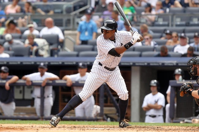 Aug 31, 2013; Bronx, NY, USA; New York Yankees left fielder Curtis Granderson (14) bats against the Baltimore Orioles during a game at Yankee Stadium. Mandatory Credit: Brad Penner-USA TODAY Sports