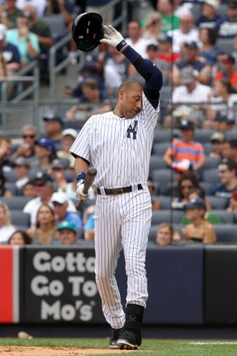 Aug 31, 2013; Bronx, NY, USA; New York Yankees shortstop Derek Jeter (2) steps to the plate against the Baltimore Orioles during a game at Yankee Stadium. Mandatory Credit: Brad Penner-USA TODAY Sports