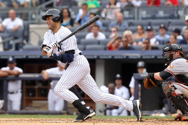 Aug 31, 2013; Bronx, NY, USA; New York Yankees shortstop Derek Jeter (2) bats against the Baltimore Orioles during a game at Yankee Stadium. Mandatory Credit: Brad Penner-USA TODAY Sports