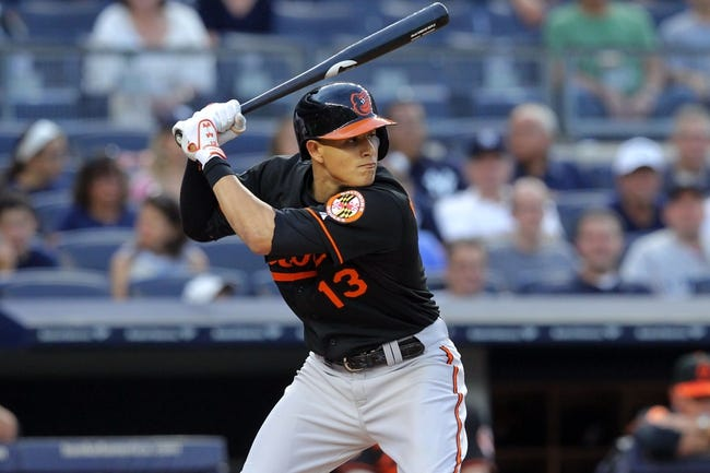Aug 30, 2013; Bronx, NY, USA; Baltimore Orioles third baseman Manny Machado (13) bats against the New York Yankees during a game at Yankee Stadium. Mandatory Credit: Brad Penner-USA TODAY Sports