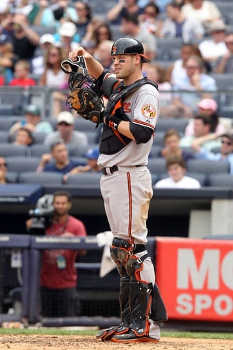 Aug 31, 2013; Bronx, NY, USA; Baltimore Orioles catcher Matt Wieters (32) behind the plate against the New York Yankees during a game at Yankee Stadium. Mandatory Credit: Brad Penner-USA TODAY Sports
