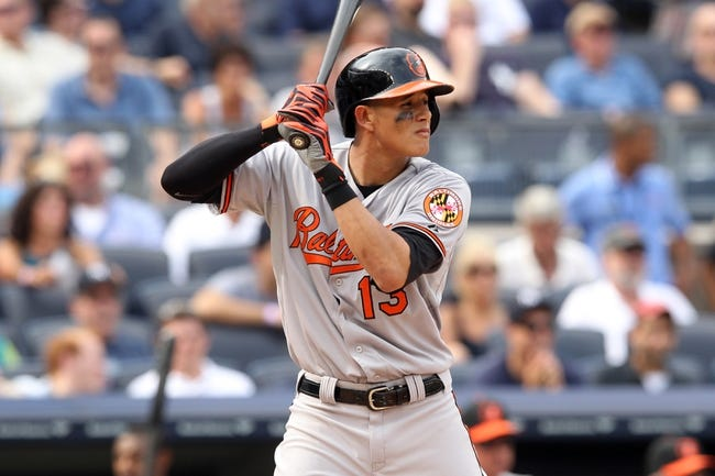 Aug 31, 2013; Bronx, NY, USA; Baltimore Orioles third baseman Manny Machado (13) bats against the New York Yankees during a game at Yankee Stadium. Mandatory Credit: Brad Penner-USA TODAY Sports