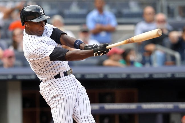 Aug 31, 2013; Bronx, NY, USA; New York Yankees designated hitter Alfonso Soriano (12) bats against the Baltimore Orioles during a game at Yankee Stadium. Mandatory Credit: Brad Penner-USA TODAY Sports