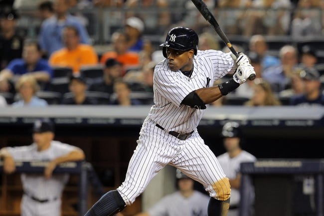 Aug 30, 2013; Bronx, NY, USA; New York Yankees designated hitter Curtis Granderson (14) bats against the Baltimore Orioles during a game at Yankee Stadium. Mandatory Credit: Brad Penner-USA TODAY Sports