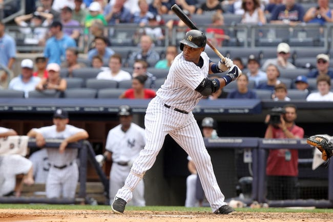 Aug 31, 2013; Bronx, NY, USA; New York Yankees second baseman Robinson Cano (24) bats against the Baltimore Orioles during a game at Yankee Stadium. Mandatory Credit: Brad Penner-USA TODAY Sports