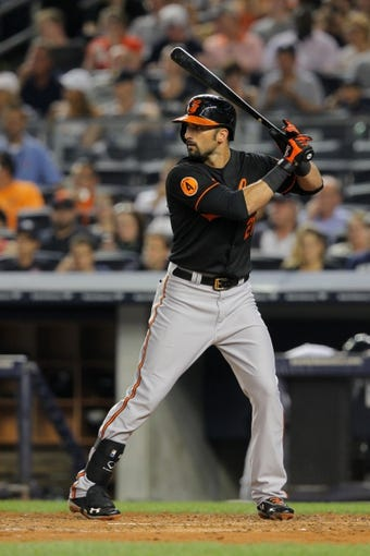 Aug 30, 2013; Bronx, NY, USA; Baltimore Orioles right fielder Nick Markakis (21) bats against the New York Yankees during a game at Yankee Stadium. Mandatory Credit: Brad Penner-USA TODAY Sports