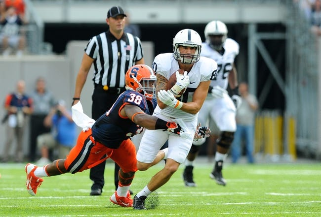 Aug 31, 2013; East Rutherford, NJ, USA; Penn State Nittany Lions wide receiver Matt Zanellato (80) runs with the ball as Syracuse Orange linebacker Cameron Lynch (38) attempts to make a tackle during the second quarter at MetLife Stadium.  Penn State defeated Syracuse 23-17.  Mandatory Credit: Rich Barnes-USA TODAY Sports