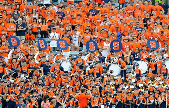 Aug 31, 2013; East Rutherford, NJ, USA; The Syracuse Orange band performs in the stands during the third quarter against the Penn State Nittany Lions at MetLife Stadium.  Penn State defeated Syracuse 23-17.  Mandatory Credit: Rich Barnes-USA TODAY Sports
