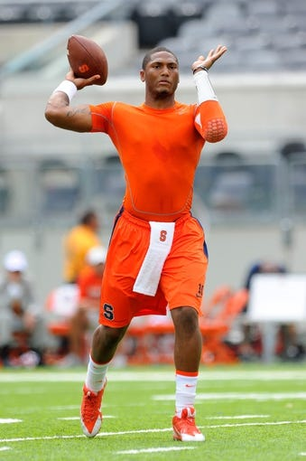 Aug 31, 2013; East Rutherford, NJ, USA; Syracuse Orange quarterback Terrel Hunt (10) warms up prior to the game against the Penn State Nittany Lions at MetLife Stadium.  Penn State defeated Syracuse 23-17.  Mandatory Credit: Rich Barnes-USA TODAY Sports
