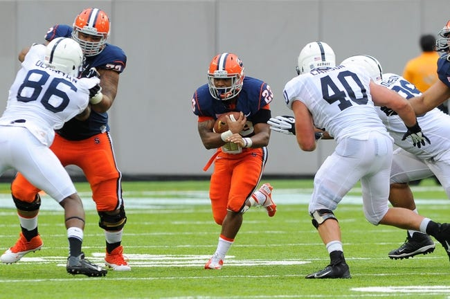 Aug 31, 2013; East Rutherford, NJ, USA; Syracuse Orange running back Prince-Tyson Gulley (23) runs with the ball during the second quarter against the Penn State Nittany Lions at MetLife Stadium.  Penn State defeated Syracuse 23-17.  Mandatory Credit: Rich Barnes-USA TODAY Sports