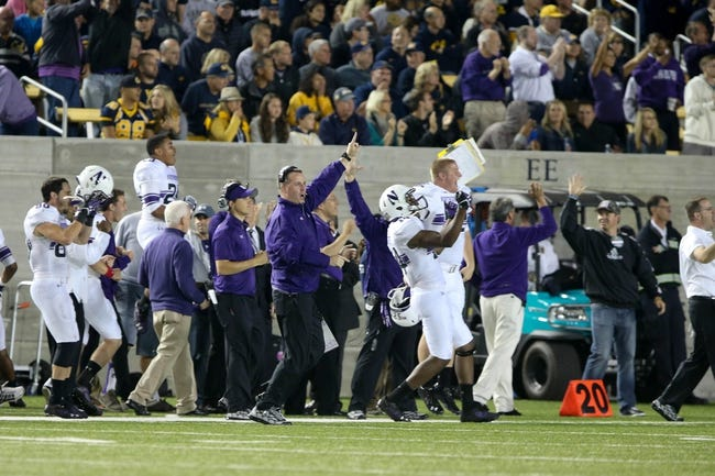 Aug 31, 2013; Berkeley, CA, USA; Northwestern Wildcats head coach Pat Fitzgerald and sideline celebrate during an interception run for a touchdown against the California Golden Bears during the third quarter at Memorial Stadium. The Northwestern Wildcats defeated the California Golden Bears 44-30. Mandatory Credit: Kelley L Cox-USA TODAY Sports