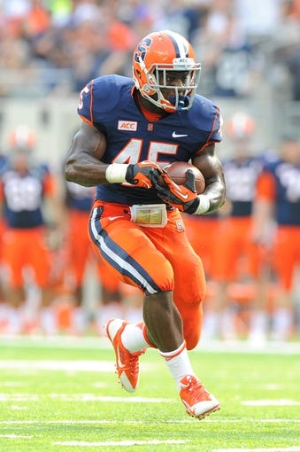 Aug 31, 2013; East Rutherford, NJ, USA; Syracuse Orange running back Jerome Smith (45) runs with the ball during the second quarter against the Penn State Nittany Lions at MetLife Stadium.  Penn State defeated Syracuse 23-17.  Mandatory Credit: Rich Barnes-USA TODAY Sports