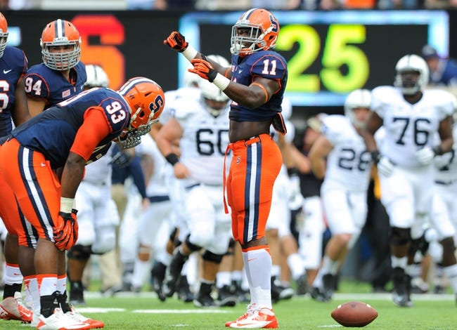 Aug 31, 2013; East Rutherford, NJ, USA; Syracuse Orange linebacker Marquis Spruill (11) calls a defensive play during the first quarter against the Penn State Nittany Lions at MetLife Stadium.  Penn State defeated Syracuse 23-17.  Mandatory Credit: Rich Barnes-USA TODAY Sports