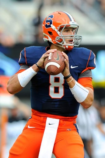 Aug 31, 2013; East Rutherford, NJ, USA; Syracuse Orange quarterback Drew Allen (8) drops back to pass during the first quarter against the Penn State Nittany Lions at MetLife Stadium.  Penn State defeated Syracuse 23-17.  Mandatory Credit: Rich Barnes-USA TODAY Sports