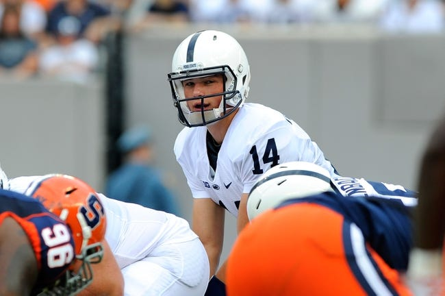 Aug 31, 2013; East Rutherford, NJ, USA; Penn State Nittany Lions quarterback Christian Hackenberg (14) scans the field at the line during the first quarter against the Syracuse Orange at MetLife Stadium.  Penn State defeated Syracuse 23-17.  Mandatory Credit: Rich Barnes-USA TODAY Sports