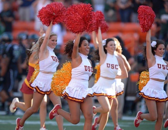 Aug 29, 2013; Honolulu, HI, USA; Southern California Trojans song girls cheerleaders lead players onto the field before the game against the Hawaii Rainbow Warriors at Aloha Stadium. USC defeated Hawaii 30-13. Mandatory Credit: Kirby Lee-USA TODAY Sports