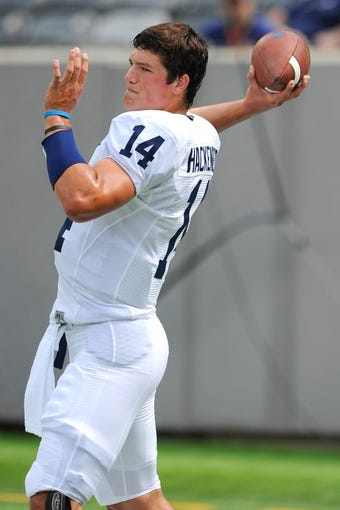 Aug 31, 2013; East Rutherford, NJ, USA; Penn State Nittany Lions quarterback Christian Hackenberg (14) warms up prior to the game against the Syracuse Orange at MetLife Stadium.  Penn State defeated Syracuse 23-17.  Mandatory Credit: Rich Barnes-USA TODAY Sports
