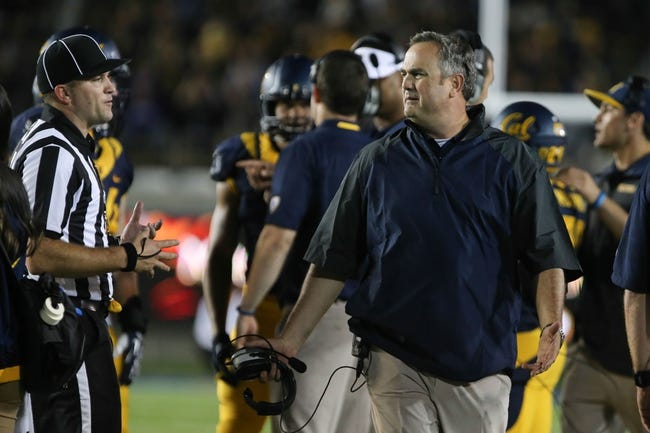 Aug 31, 2013; Berkeley, CA, USA; California Golden Bears head coach Sonny Dykes reacts after an injury time by the Northwestern Wildcats during the third quarter at Memorial Stadium. The Northwestern Wildcats defeated the California Golden Bears 44-30. Mandatory Credit: Kelley L Cox-USA TODAY Sports