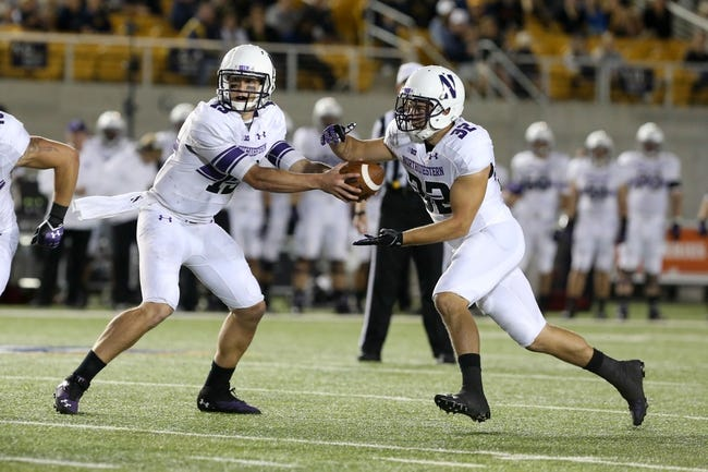 Aug 31, 2013; Berkeley, CA, USA; Northwestern Wildcats quarterback Trevor Siemian (13) hands off the ball to running back Mike Trumpy (32) during the fourth quarter at Memorial Stadium. Northwestern won 44-30. Mandatory Credit: Kelley L Cox-USA TODAY Sports