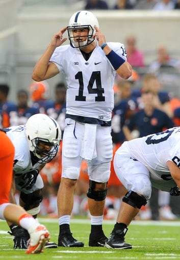 Aug 31, 2013; East Rutherford, NJ, USA; Penn State Nittany Lions quarterback Christian Hackenberg (14) calls a play at the line during the third quarter against the Syracuse Orange at MetLife Stadium.  Penn State defeated Syracuse 23-17.  Mandatory Credit: Rich Barnes-USA TODAY Sports