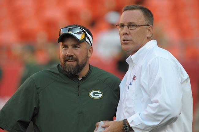 Aug 29, 2013; Kansas City, MO, USA; Green Bay Packers football administration coordinator Matt Klein talks with Kansas City Chiefs general manager John Dorsey before the game at Arrowhead Stadium. The Chiefs won 30-8. Mandatory Credit: Denny Medley-USA TODAY Sports