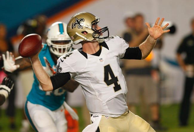 Aug 29, 2013; Miami Gardens, FL, USA; New Orleans Saints quarterback Ryan Griffin (4) passes the ball in the fourth quarter against the Miami Dolphins at Sun Life Stadium. Mandatory Credit: Robert Mayer-USA TODAY Sports