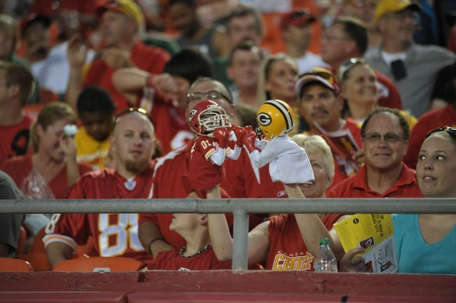Aug 29, 2013; Kansas City, MO, USA; A Kansas City Chiefs fan displays boxing puppets during the game against the Green Bay Packers at Arrowhead Stadium. The Chiefs won 30-8. Mandatory Credit: Denny Medley-USA TODAY Sports