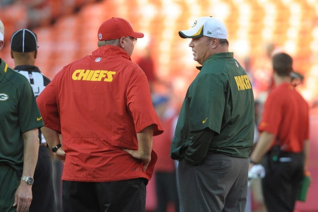 Aug 29, 2013; Kansas City, MO, USA; Kansas City Chiefs head coach Andy Reid talks with Green Bay Packers head coach Mike McCarthy before the game at Arrowhead Stadium. Mandatory Credit: Denny Medley-USA TODAY Sports