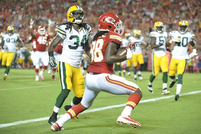 Aug 29, 2013; Kansas City, MO, USA; Kansas City Chiefs wide receiver Junior Hemingway (88) catches a pass for a touchdown as Green Bay Packers defensive back Brandon Smith (34) defends during the first half of the game at Arrowhead Stadium. The Chiefs won 30-8. Mandatory Credit: Denny Medley-USA TODAY Sports