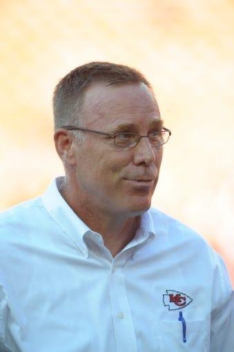 Aug 29, 2013; Kansas City, MO, USA; Kansas City Chiefs general manager John Dorsey watches warmup on the sidelines before the game against the Green Bay Packers at Arrowhead Stadium. The Chiefs won 30-8. Mandatory Credit: Denny Medley-USA TODAY Sports