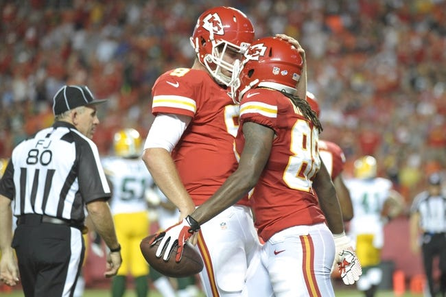 Aug 29, 2013; Kansas City, MO, USA; Kansas City Chiefs wide receiver Junior Hemingway (88) is congratulated by quarterback Tyler Bray (9) after scoring a touchdown during the first half of the game against the Green Bay Packers at Arrowhead Stadium. The Chiefs won 30-8. Mandatory Credit: Denny Medley-USA TODAY Sports