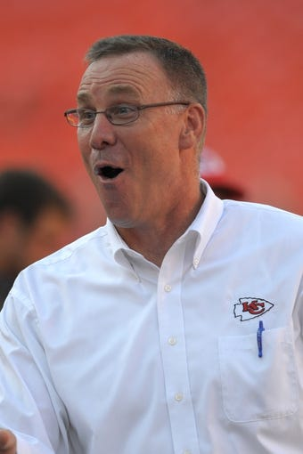 Aug 29, 2013; Kansas City, MO, USA; Kansas City Chiefs general manager John Dorsey talks to players on the sidelines before the game against the Green Bay Packers at Arrowhead Stadium. The Chiefs won 30-8. Mandatory Credit: Denny Medley-USA TODAY Sports