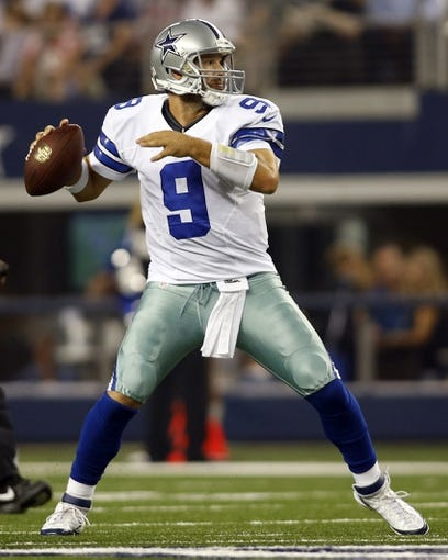 Aug 24, 2013; Arlington, TX, USA; Dallas Cowboys quarterback Tony Romo (9) throws a pass in the second quarter of the game against the Cincinnati Bengals at AT&T Stadium. Mandatory Credit: Tim Heitman-USA TODAY Sports