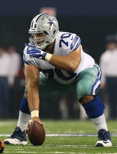 Aug 24, 2013; Arlington, TX, USA; Dallas Cowboys center Travis Frederick (70) points in the second quarter against the Cincinnati Bengals at AT&T Stadium. Mandatory Credit: Matthew Emmons-USA TODAY Sports