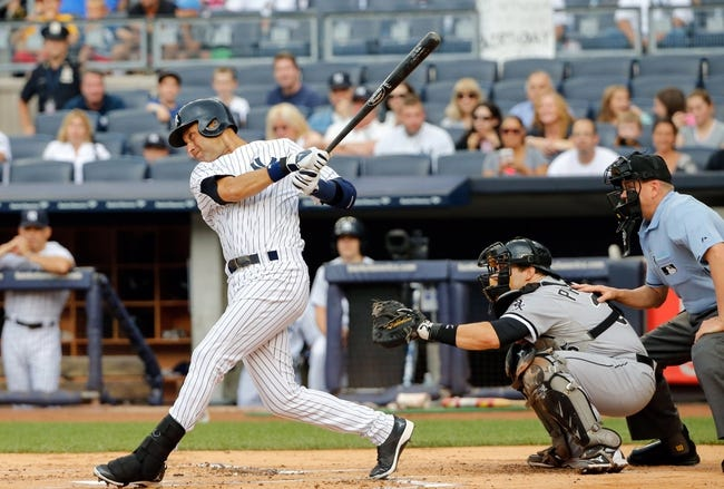 Sep 2, 2013; Bronx, NY, USA;  New York Yankees shortstop Derek Jeter (2) hits an RBI single during the first inning against the Chicago White Sox at Yankee Stadium. Mandatory Credit: Anthony Gruppuso-USA TODAY Sports