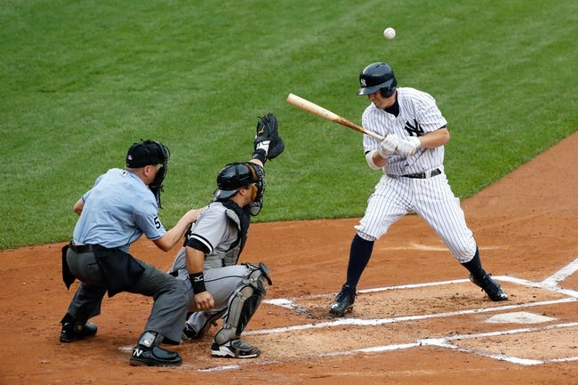 Sep 2, 2013; Bronx, NY, USA;  New York Yankees first baseman Mark Reynolds (39) is hit by a pitch during the second inning against the Chicago White Sox at Yankee Stadium. Mandatory Credit: Anthony Gruppuso-USA TODAY Sports