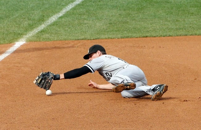 Sep 2, 2013; Bronx, NY, USA;  Chicago White Sox third baseman Conor Gillaspie (12) misses the catch during the fourth inning against the New York Yankees at Yankee Stadium. Mandatory Credit: Anthony Gruppuso-USA TODAY Sports