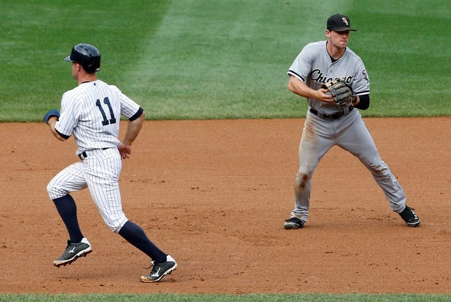 Sep 2, 2013; Bronx, NY, USA;  New York Yankees center fielder Brett Gardner (11) heads to third as Chicago White Sox third baseman Conor Gillaspie (12) handles the ball during the fourth inning at Yankee Stadium. Mandatory Credit: Anthony Gruppuso-USA TODAY Sports
