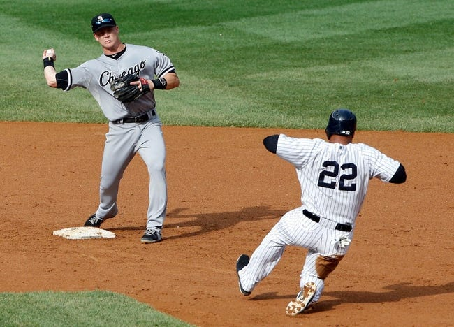 Sep 2, 2013; Bronx, NY, USA;  Chicago White Sox second baseman Gordon Beckham (15) has New York Yankees left fielder Vernon Wells (22) out during the fourth inning at Yankee Stadium. Mandatory Credit: Anthony Gruppuso-USA TODAY Sports