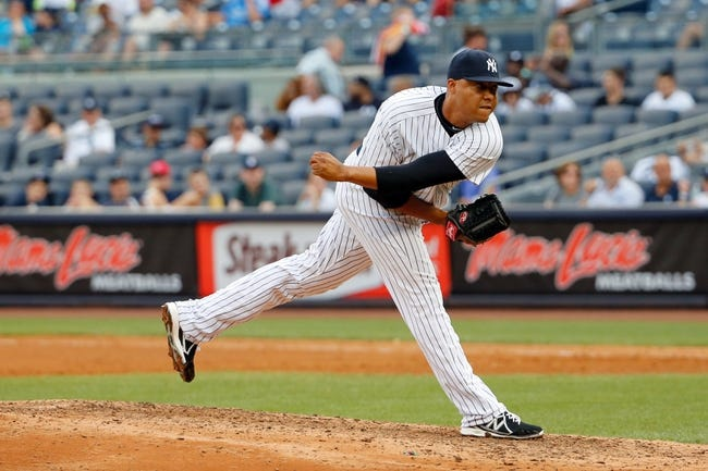 Sep 2, 2013; Bronx, NY, USA;  New York Yankees relief pitcher Cesar Cabral (64) delivers a pitch during the eighth inning against the Chicago White Sox at Yankee Stadium. Yankees won 9-1.  Mandatory Credit: Anthony Gruppuso-USA TODAY Sports